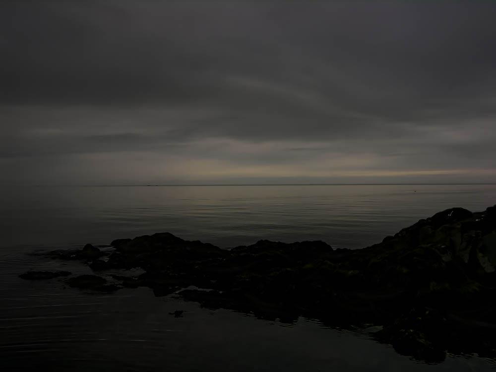 Fog at Twilight; Horizon Blending Sky and Water (Nightlandscape in Newfoundland)